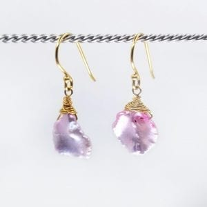 """Drop earrings with pink Keshi pearls. 1..25"""" long with hand forged shepards hook ear wires"""