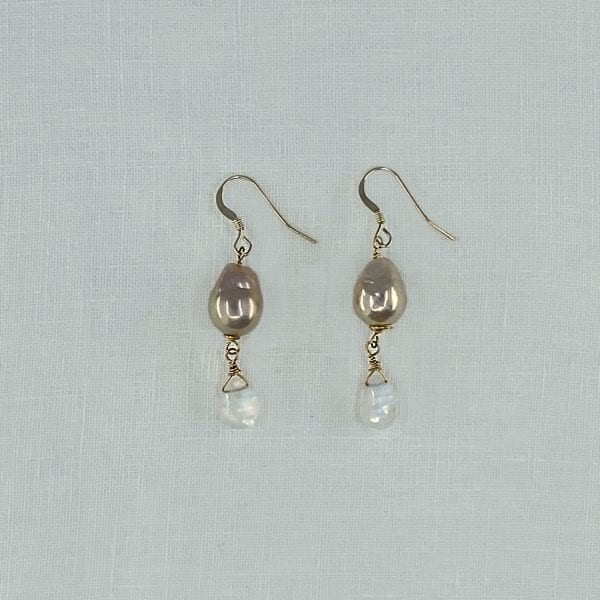 """Baroque Pearl and Moonstone drop earrings. Champagne colored baroque pearls top moonstone briolettes. 1.5"""" long with hand forged shepards hook ear wires"""