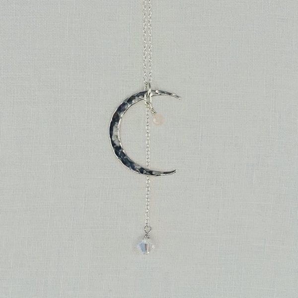 "Sterling Silver Crescent Moon necklace with Rose Quartz accent and Crystal Drop. Sterling silver chain has a finished length of 24"" long."