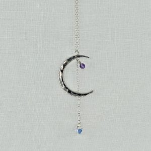 """Sterling Silver Crescent Moon necklace with Amethyst accent and Crystal Drop. Sterling silver chain has a finished length of 24"""" long."""