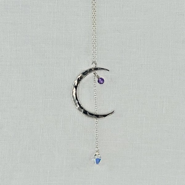 "Sterling Silver Crescent Moon necklace with Amethyst accent and Crystal Drop. Sterling silver chain has a finished length of 24"" long."