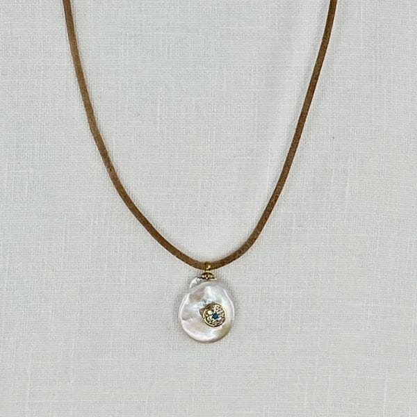 "Small baroque pearl necklace with evil eye paved with crystals. Leather cord necklace is 18"" long."