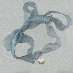 "Baroque pearl is suspended on a light blue colored silk faille ribbon. Ribbon can be tied to any length up to 36"" long."