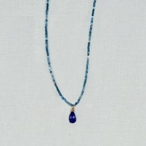 "Sapphire briolette is the centerpiece of an 18"" long necklace with 3mm apatite beads."