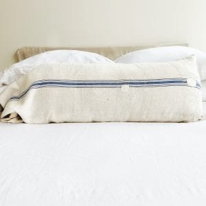 """A vintage grain sack made from linen and hemp. Five horizontal stripes are running horizontally and also has multiple patches. Measurements: 51"""" long x 18.5"""" high"""