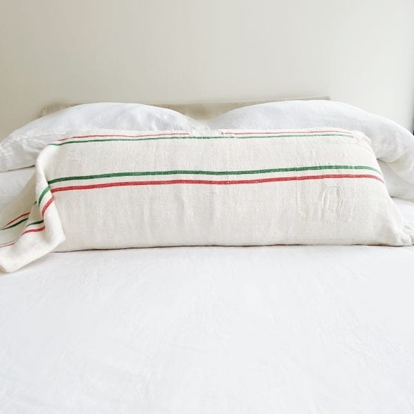 "A vintage grain sack made from linen and hemp. Natural in color, there are two red and two green stripes running horizontally. Green is a rare color used in grain sacks. Measurements: 46""L x 17.5"" high."