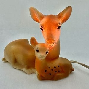 Doe and Fawn night-light. Spotted fawn is nestled into her mother. The night-light illuminates the head of the doe. Made of rubber and signed on the bottom with 1964 Bonnytex.