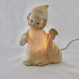 Mr. Sandman is dressed in his sleeping gown and holds his bag of sleepy seeds. Made of ceramic, he glows a pale yellow when illuminated.