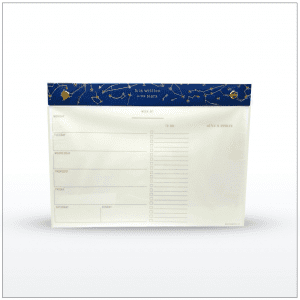 "Desk planner with 60 perforated sheets and a constellation design in gold foil with blue cloth binding. Size: 10"" x 7.25"""