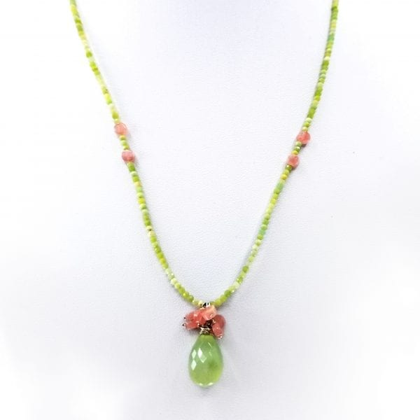"A faceted prehnite pendant with green opal beads. On top of the prehnite is a cluster of rhodochrosite. Length is 16"" with a 2"" extender chain."