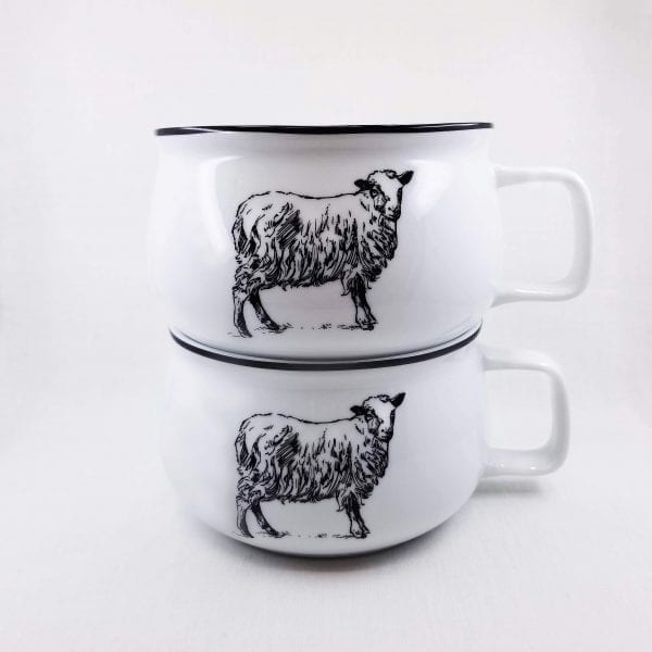 """Oversized mug with sheep decoration has a 20 ounce capacity. Dishwasher and microwave safe. Measures 3""""H x 5"""" W"""