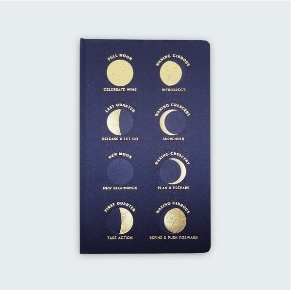 Cloth bound journal with the phases of the moon embossed on the front.
