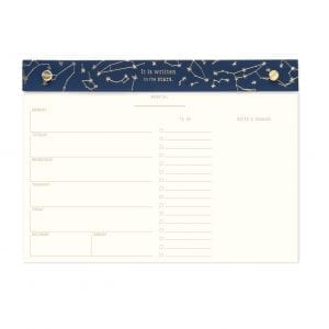 """Desk planner with 60 perforated sheets and a constellation design in gold foil with blue cloth binding. Size: 10"""" x 7.25"""""""