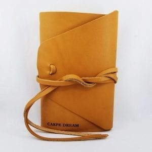 "Leather journal with double wrap tie closure. Comes with 160 blank pages. Embossed ""Carpe Dream"". Size 6.25"" x 9"". Color: Buckskin"