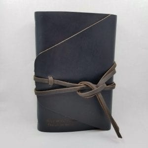 "Leather journal with double wrap tie closure. Comes with 160 blank pages. Embossed ""Sleep In The Clouds"". Size 6.25"" x 9"". Color: Ocean"