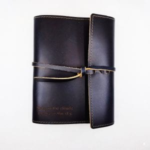 """Refillable leather journal with leather tie closure. Embossed: """"Sleep In The Clouds"""". Size: 6.75"""" x 8.75"""". Color: Ocean"""