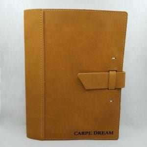 "Leather notebook that holds a 9.75"" x 7.5"" composition notebook. Embossed: ""Carpe Dream"". Size: 10.25"" x 8"". Color: Buckskin"