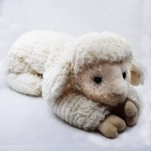 """Soft, weighted plush lamb made with soft ribbed fur. Weighted and can be posed in three positions: lay flat, sit up and drape. Machine wash and air dry. Size: 17"""" L"""