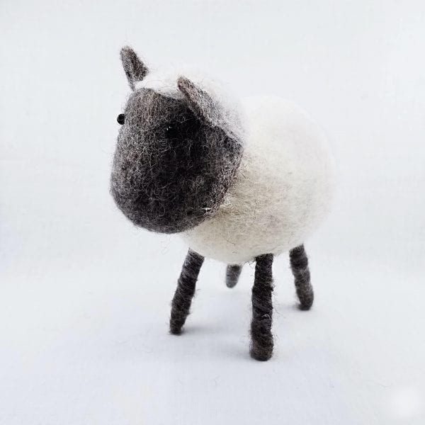 """Handmade felt sheep made by Nepalese women and certified as 100% Fair Trade. Color: White. Size: 7.5""""H"""