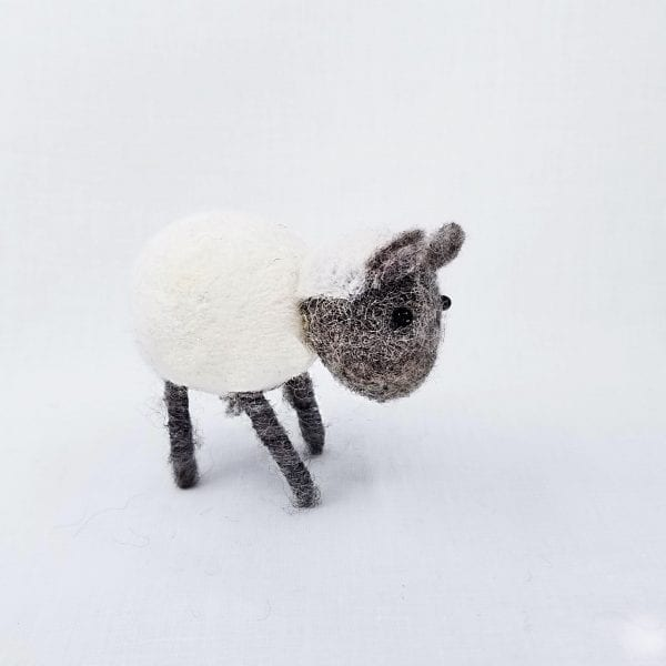"""Handmade felt sheep made by Nepalese women and certified as 100% Fair Trade. Color: White. Size: 3""""H"""