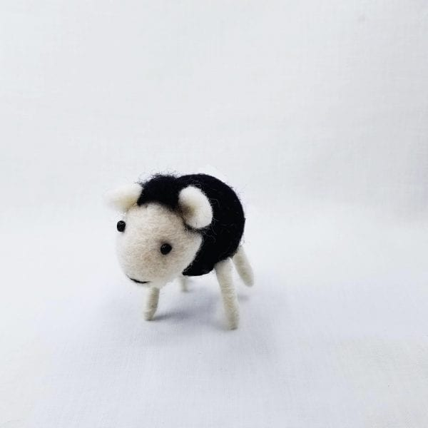 """Handmade felt sheep made by Nepalese women and certified as 100% Fair Trade. Color: Black. Size: 3""""H"""