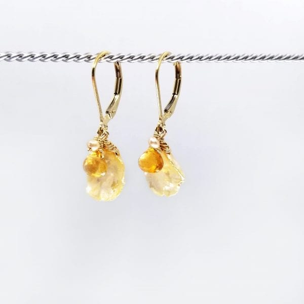 """Keshi and citrine drop earrings are finished with a gold-filled, lever back closure. They measure 1.25"""" long."""