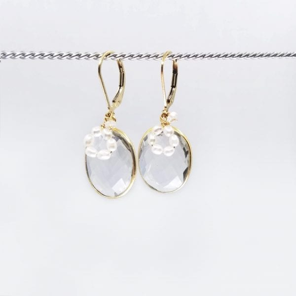 """Oval quartz and freshwater pearl drop earrings are finished with a gold-filled, lever back closure. The earrings measure 1.5"""" long."""