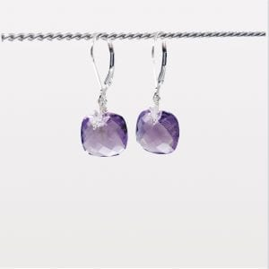 "Cushion shape, checkerboard cut amethyst with herkimer quartz earrings are finished with a gold-filled, lever back closure. The earrings measure 1.25"" long."