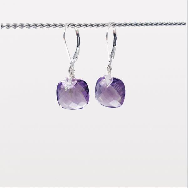 """Cushion shape, checkerboard cut amethyst with herkimer quartz earrings are finished with a gold-filled, lever back closure. The earrings measure 1.25"""" long."""