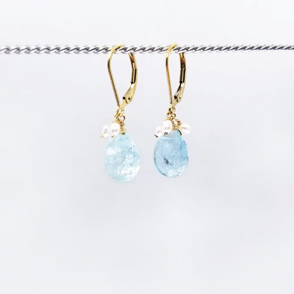 """Teardrop aquamarine earrings, with freshwater pearl cluster are finished with a gold-filled, lever back closure. The earrings measure 1.25"""" long."""
