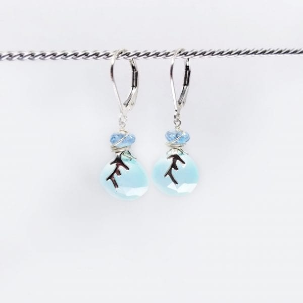 """Chalcedony drops have small apatite beads set above and the earrings are finished with sterling silver lever back closure. The earrings measure 1.25"""" long."""