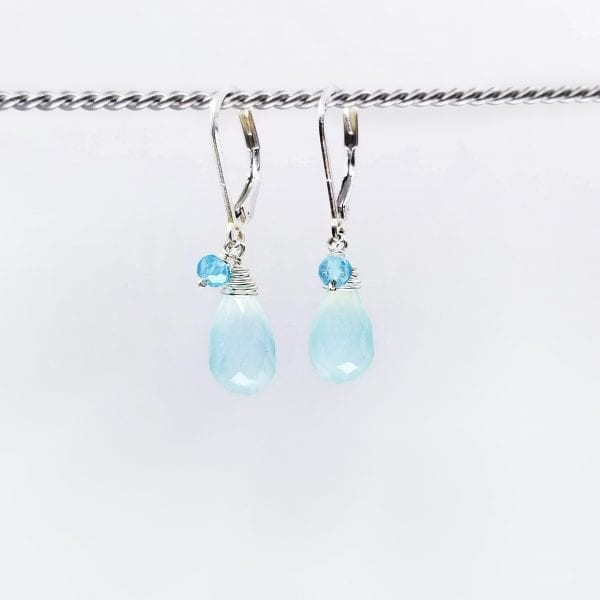 """Chalcedony and apatite drop earrings are finished with a sterling silver, lever back closure. The earrings measure 1.25"""" long."""