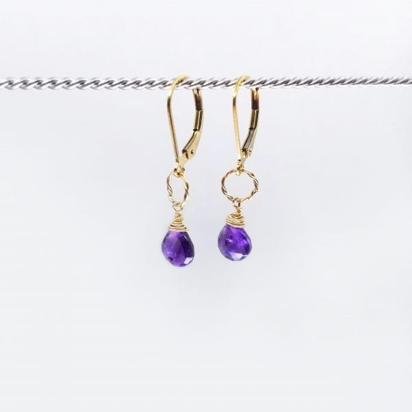 """Small amethyst briolettes earrings are suspended from gold-filled, lever back closure. The earrings measure 1.25"""" long."""
