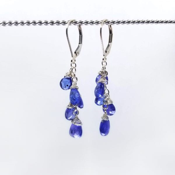 "Tanzanite graduated briolettes cascade from gold-filled, lever back closure earrings. The earrings measure 2"" long."