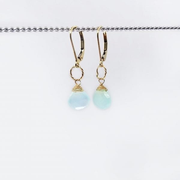 "Chalcedony drops are attached to small twisted metal rings on gold-filled, lever back closure earrings. The earrings measure 1.25"" long."