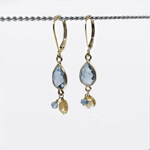 "Marquis cut blue topaz with citrine drops are suspended on gold-filled, lever back closure earrings. The earrings measure 1.75"" long."