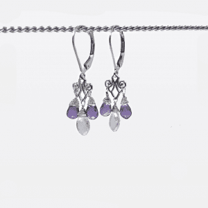 "Rainbow moonstone and amethyst briolettes are set in the chandelier style with sterling silver, lever back closures. The earrings measure 1.25"" long."