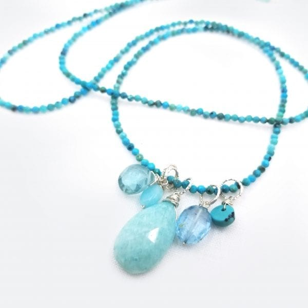 "A 30"" stand of turquoise beads with a teardrop shaped amazonite has blue topaz, aquamarine, and icy quartz floating drops. Necklace has a 2"" extender chain."