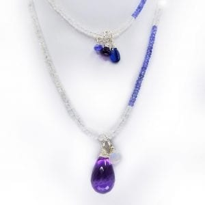 "A 30"" strand of amethyst and rainbow moonstone beads with a teardrop, faceted amethyst has tanzanite, kyanite, and rainbow moonstone floating drops. Necklace has 2"" extender chain."