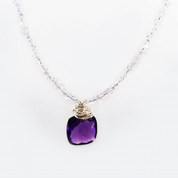 """Amethyst pendant in a cushion cut with checkerboard faceting. The necklace is finished with Herkimer quartz and is 16"""" with a 2"""" extender chain."""
