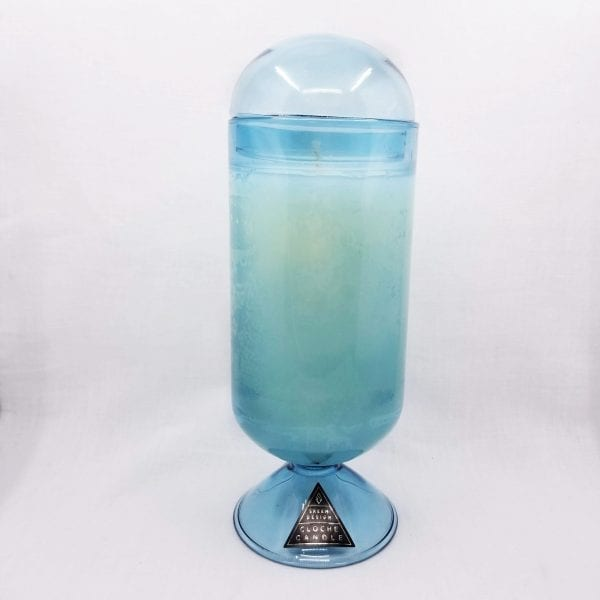 Tall glass cloche candle with a removable dome in a heady blend of jasmine and lotus flowers. Candle burns 120 hours.
