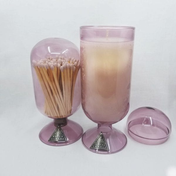 Tall glass cloche candle with a removable dome in a sweet currant blend cut with citrus peels. Candle burns 120 hours.