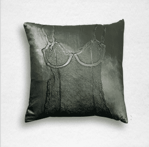 "Dark green velvet pillow is embossed with a lace camisole and measures 20""x20""."