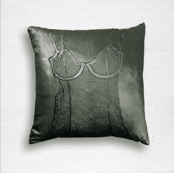 """Dark green velvet pillow is embossed with a lace camisole and measures 20""""x20""""."""