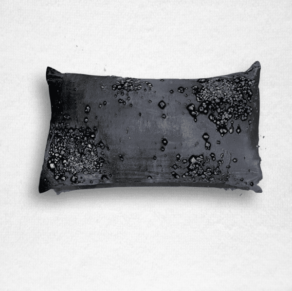 "Velvet with hues of deep purple with a mineral scatter print. Pillow measures 12""x20""."