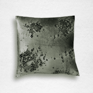 "Dark green velvet pillow is embossed with a mineral scatter print. Measures 20""x20""."