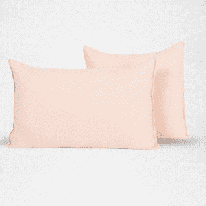 "Linen pillow with eyelash fringe. Measures 18""x18"". Color: Nude"