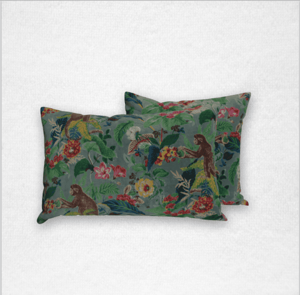 "Rectangular velvet pillow with a monkey and floral pattern, measures 16""x24"". Color: Celadon"