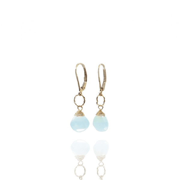 """Chalcedony drops are attached to small twisted metal rings on gold-filled, lever back closure earrings. The earrings measure 1.25"""" long."""