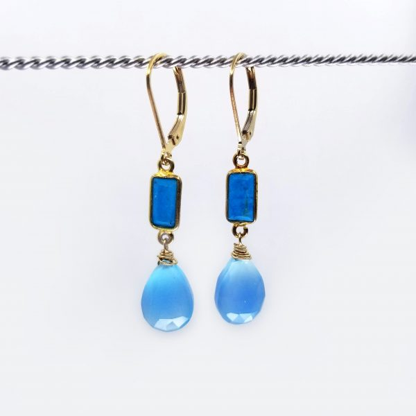 "Calcedony drops with rectangular turquoise howlite set above and finished with gold-filled lever back closure. The earrings measure 1.5"" long."